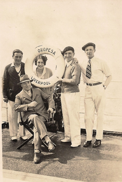 "Mr Wolfsohn, Miss Whiteley, ""Scottie"" & Mr A F Seeley in front of Mr Chalmers on the RMS Oropesa April 1928 (taken by Seeley's camera)"
